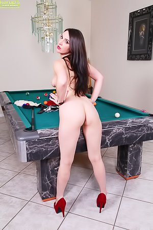 Red skirt pale-looking brunette enjoying hardcore fingering on a pool table