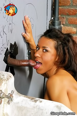 Busty and tanned brunette Latina MILF sucking a BBC via a glory hole