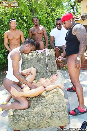 Busty/lusty blonde bimbo gets gang-banged by black dudes outdoors