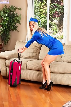 Flight attendant MILF blonde showing her perfect pussy on a couch