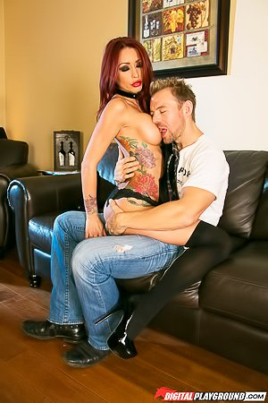 Wavy-haired MILF redhead gets banged by a big-dicked dude on a couch