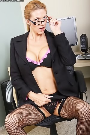 Glasses-wearing MILF in stockings slowly undressing at the office