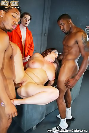 Glasses-wearing MILF sucking BBCs in the prison to help her son