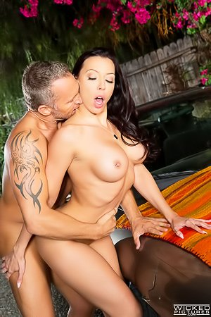 Tanned and busty brunette MILF gets banged on the hood of a car