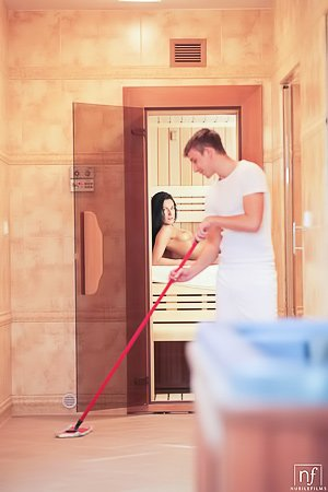 Skinny brunette with long legs decides to fuck the janitor in a sauna
