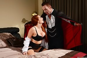 Redhead dressed in black gets fucked by a big-dicked vampire