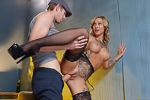 Tatted-up blonde in black stockings and pumps gets pounded hardcore
