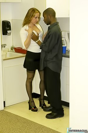 Amateur-looking redheaded MILF gets brutally blacked at the office