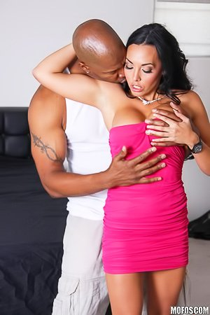 Dress-wearing brunette MILF fucking a big-dicked black guy here
