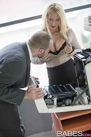Busty office blonde gets her smooth MILF pussy fucked on a desk