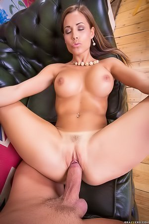 Tanned bombshell gets all of her holes pounded on a leather couch